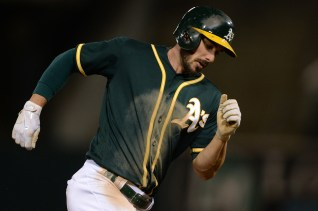 Oakland Athletics right fielder Matt Joyce (23) rounds the bases after a home run in the fifth inning off of San Francisco Giants pitcher Jeff Samardzija (29) as the San Francisco Giants face the Oakland Athletics at Oakland Coliseum in Oakland, Calif., on Tuesday, August 1, 2017.
