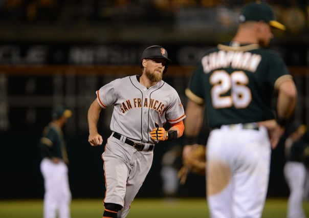 San Francisco Giants right fielder Hunter Pence (8) homers in the eighth inning as the San Francisco Giants face the Oakland Athletics at Oakland Coliseum in Oakland, Calif., on Tuesday, August 1, 2017.