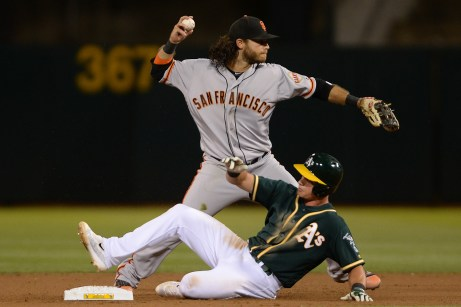San Francisco Giants shortstop Brandon Crawford (35) forces out Oakland Athletics center fielder Jaycob Brugman (38) and turns a double play on Joyce in the seventh inning as the San Francisco Giants face the Oakland Athletics at Oakland Coliseum in Oakland, Calif., on Tuesday, August 1, 2017.