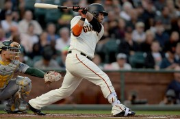 San Francisco Giants shortstop Brandon Crawford (35) singles in the first inning as the Oakland Athletics face the San Francisco Giants at AT&T Park in San Francisco, Calif., on Thursday, August 3, 2017.