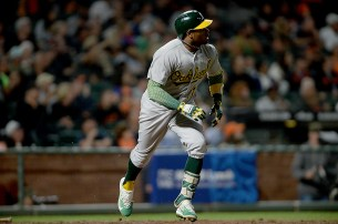 Oakland Athletics center fielder Rajai Davis (11) connects for a solo home run as the Oakland Athletics face the San Francisco Giants at AT&T Park in San Francisco, Calif., on Thursday, August 3, 2017.