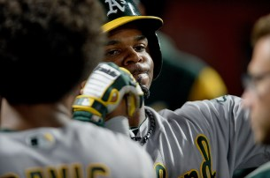 Oakland Athletics center fielder Rajai Davis (11) is congratulated by Khris Davis (2) after a solo home run as the Oakland Athletics face the San Francisco Giants at AT&T Park in San Francisco, Calif., on Thursday, August 3, 2017.