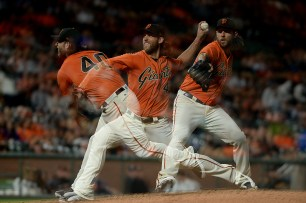 San Francisco Giants starting pitcher Madison Bumgarner (40) throws a pitch in the sixth inning shown in a multiple exposure as the Arizona Diamondbacks face the San Francisco Giants at AT&T Park in San Francisco, Calif., on Friday, August 4, 2017.