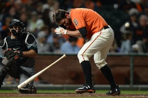 San Francisco Giants first baseman Brandon Belt (9) is hit by a pitch in the sixth inning as the Arizona Diamondbacks face the San Francisco Giants at AT&T Park in San Francisco, Calif., on Friday, August 4, 2017.