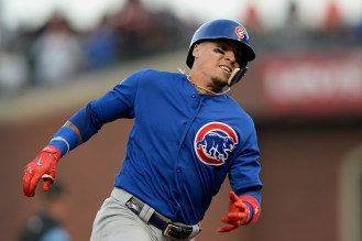 Chicago Cubs shortstop Javier Báez (9) rounds third base for an inside the park home run as the Chicago Cubs face the San Francisco Giants at AT&T Park in San Francisco, Calif., on Monday, August 7, 2017.