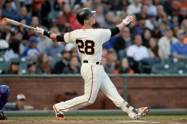 San Francisco Giants first baseman Buster Posey (28) connects for a 3-run home run in the first inning as the Chicago Cubs face the San Francisco Giants at AT&T Park in San Francisco, Calif., on Tuesday, August 8, 2017.