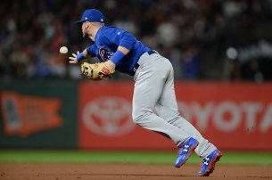Chicago Cubs second baseman Ian Happ (8) tosses the ball to force out San Francisco Giants third baseman Pablo Sandoval (48) in the seventh inning as the Chicago Cubs face the San Francisco Giants at AT&T Park in San Francisco, Calif., on Tuesday, August 8, 2017.