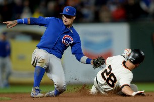San Francisco Giants first baseman Buster Posey (28) steals second base in the eighth inning as the Chicago Cubs face the San Francisco Giants at AT&T Park in San Francisco, Calif., on Tuesday, August 8, 2017.