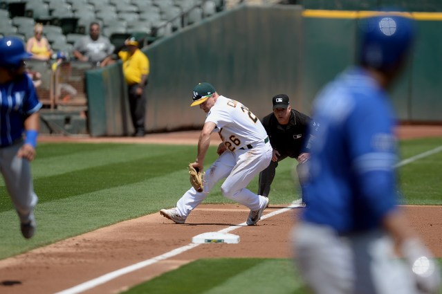 Kansas City Royals shortstop Alcides Escobar (2) grounds out to Oakland Athletics third baseman Matt Chapman (26) with the bases loaded in the first inning as the Kansas City Royals face the Oakland Athletics at Oakland Coliseum in Oakland, Calif., on Wednesday, August 16, 2017.