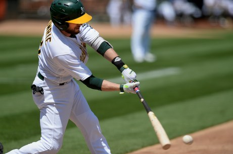 Oakland Athletics second baseman Jed Lowrie (8) grounds out in the third inning as the Kansas City Royals face the Oakland Athletics at Oakland Coliseum in Oakland, Calif., on Wednesday, August 16, 2017.