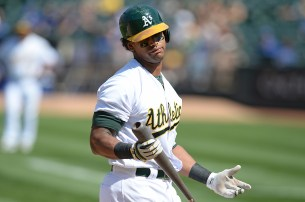 Oakland Athletics left fielder Khris Davis (2) strikes out in the seventh inning as the Kansas City Royals face the Oakland Athletics at Oakland Coliseum in Oakland, Calif., on Wednesday, August 16, 2017.