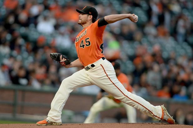 San Francisco Giants pitcher Matt Moore (45) throws a pitch in the first inning as the Philadelphia Phillies face the San Francisco Giants at AT&T Park in San Francisco, Calif., on Friday, August 18, 2017.