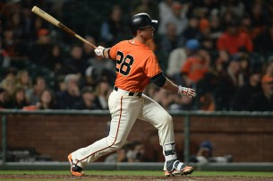 San Francisco Giants catcher Buster Posey (28) doubles in the fifth inning as the Philadelphia Phillies face the San Francisco Giants at AT&T Park in San Francisco, Calif., on Friday, August 18, 2017.