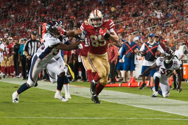 San Francisco 49ers tight end George Kittle (85) takes the ball to the end zone on a 29-yard reception in the thrid quarter of the game against the Denver Broncos at Levi's Stadium in Santa Clara, Calif., on August 19, 2017.