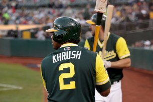 Oakland Athletics left fielder Khris Davis (2) and right fielder Matt Joyce (23) stand in the on deck circle waiting to bat in the third inning as the Texas Rangers face the Oakland Athletics at Oakland Coliseum in Oakland, Calif., on Friday, August 25, 2017.
