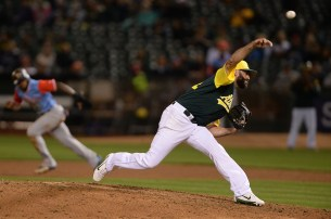 "Oakland Athletics relief pitcher Chris ""Hatch"" Hatcher (44) throws a pitch in the eighth inning as the Texas Rangers face the Oakland Athletics at Oakland Coliseum in Oakland, Calif., on Friday, August 25, 2017."