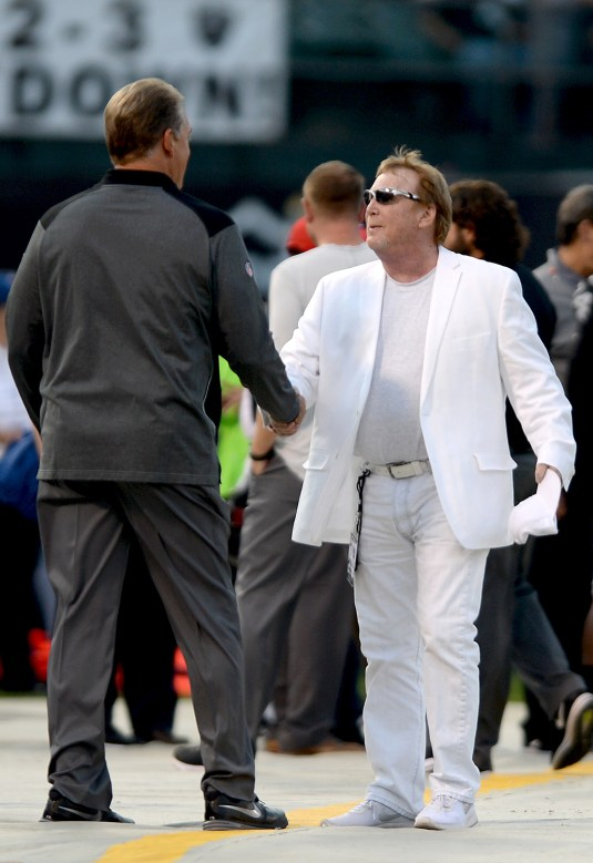 Oakland Raiders owner Mark Davis and head coach Jack Del Rio shake hands before the Seattle Seahawks face the Oakland Raiders at Oakland Coliseum in Oakland, Calif., on Thursday, August 31, 2017.