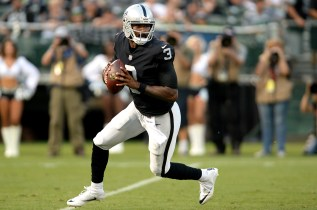 Oakland Raiders quarterback EJ Manuel (3) rolls out of the pocket in the first quarter as the Seattle Seahawks face the Oakland Raiders at Oakland Coliseum in Oakland, Calif., on Thursday, August 31, 2017.
