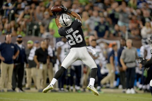 Oakland Raiders safety Shalom Luani (26) snags an interception in the first half as the Seattle Seahawks face the Oakland Raiders at Oakland Coliseum in Oakland, Calif., on Thursday, August 31, 2017.