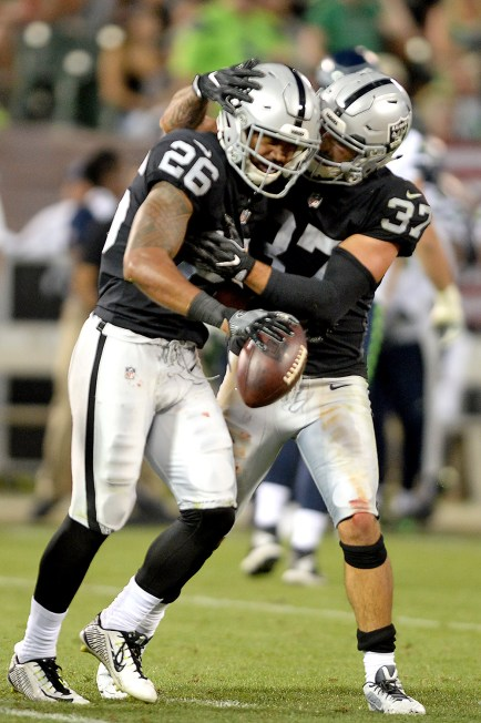 Oakland Raiders defensive back Anthony Cioffi (37) congratulates safety Shalom Luani (26) after an interception as the Seattle Seahawks face the Oakland Raiders at Oakland Coliseum in Oakland, Calif., on Thursday, August 31, 2017.