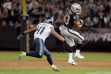 Seattle Seahawks linebacker Dewey McDonald (41) stops Oakland Raiders running back John Crockett (43) for a loss in the first half as the Seattle Seahawks face the Oakland Raiders at Oakland Coliseum in Oakland, Calif., on Thursday, August 31, 2017.