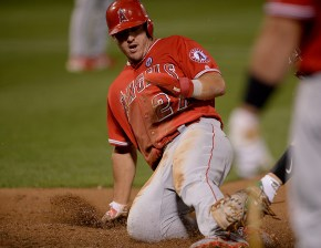 Los Angeles Angels center fielder Mike Trout (27) is tagged out at the plate as the Los Angeles Angels face the Oakland Athletics at Oakland Coliseum in Oakland, Calif., on Saturday, April 1, 2017.