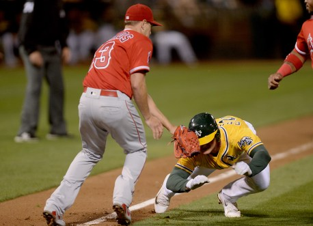 Oakland Athletics third baseman Matt Chapman (26) is tagged out by Los Angeles Angels starting pitcher Garrett Richards (43) in a pickle in the third inning as the Los Angeles Angels face the Oakland Athletics at Oakland Coliseum in Oakland, Calif., on Saturday, April 1, 2017.