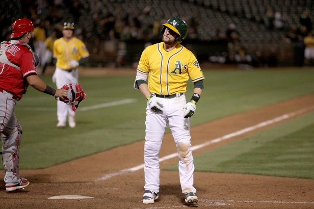 Oakland Athletics second baseman Jed Lowrie (8) reacts after recording the final out in the 8-7 loss in 10 innings against the Los Angeles Angels at Oakland Coliseum in Oakland, Calif., on Saturday, April 1, 2017.