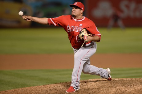 Los Angeles Angels relief pitcher Eduardo Paredes (60) throws a pitch in the tenth inning as the Los Angeles Angels face the Oakland Athletics at Oakland Coliseum in Oakland, Calif., on Saturday, April 1, 2017.