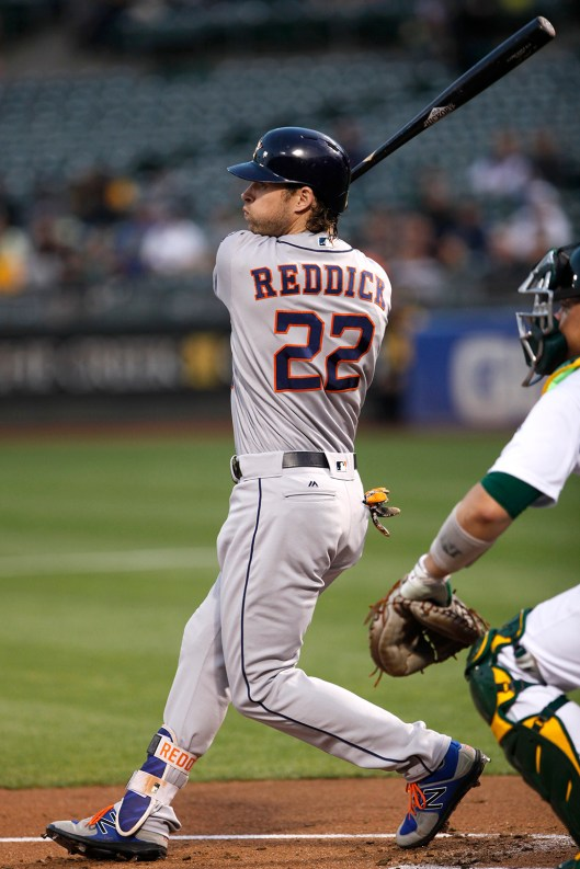 Houston Astros left fielder Josh Reddick (22) fouls a pitch in the first inning as the Houston Astros face the Oakland Athletics at the Oakland Coliseum on Friday September 08, 2017.