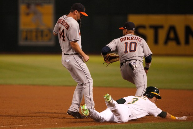 Oakland Athletics center fielder Boog Powell (3) slides into third base during the 7th inning as the Houston Astros face the Oakland Athletics at the Oakland Coliseum on Friday September 08, 2017. Athletics won 9-8.