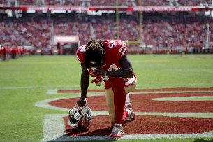 San Francisco 49ers' Ray-Ray Armstrong (54) takes a knee after player introductions as the Carolina Panthers face the San Francisco 49ers at Levi's Stadium in Santa Clara, Calif., on Sunday, September 10, 2017.