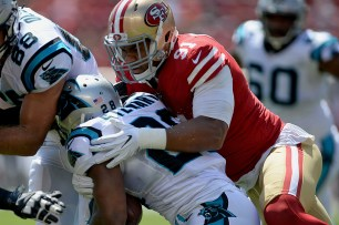 Carolina Panthers' Jonathan Stewart (28) is tackled by San Francisco 49ers' Arik Armstead (91) in the first quarter as the Carolina Panthers face the San Francisco 49ers at Levi's Stadium in Santa Clara, Calif., on Sunday, September 10, 2017.