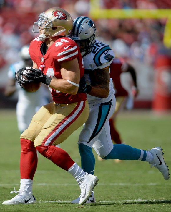 San Francisco 49ers' Kyle Juszczyk (44) is shoved out of bounds by Carolina Panthers' Kurt Coleman (20) after a catch as the Carolina Panthers face the San Francisco 49ers at Levi's Stadium in Santa Clara, Calif., on Sunday, September 10, 2017.