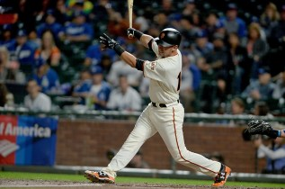 San Francisco Giants second baseman Joe Panik (12) singles in the first inning as the Los Angeles Dodgers face the San Francisco Giants at AT&T Park in San Francisco, Calif., on Monday, September 11, 2017.