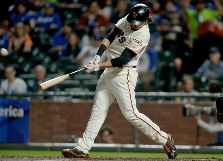 San Francisco Giants left fielder Jarrett Parker (6) connects for a home run in the second inning as the Los Angeles Dodgers face the San Francisco Giants at AT&T Park in San Francisco, Calif., on Monday, September 11, 2017.