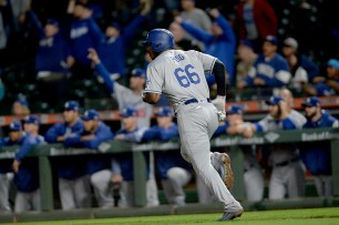 Los Angeles Dodgers right fielder Yasiel Puig (66) homers in the fifth inning as the Los Angeles Dodgers face the San Francisco Giants at AT&T Park in San Francisco, Calif., on Monday, September 11, 2017.