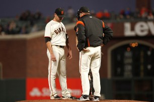San Francisco Giants pitcher Matt Moore (45) talks with pitching coach Dave Righetti (19) during the first inning as the Los Angeles Dodgers face the San Francisco Giants at the AT&T Park on Wednesday September 13, 2017.