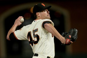 San Francisco Giants pitcher Matt Moore (45) throws a pitch in the third inning as the Los Angeles Dodgers face the San Francisco Giants at AT&T Park in San Francisco, Calif., on Wednesday, September 13, 2017.