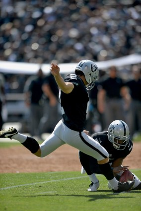 Oakland Raiders kicker Giorgio Tavecchio (2) kicks an extra point in the first half as the New York Jets face the Oakland Raiders at Oakland Coliseum in Oakland, Calif., on Sunday, September 17, 2017.