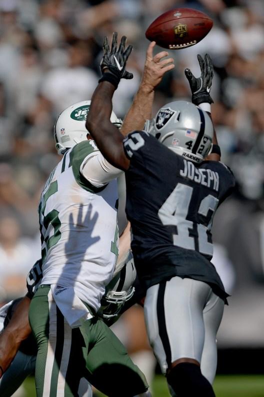 Oakland Raiders safety Karl Joseph (42) applies pressure to the New York Jets quarterback Josh McCown (15) as the New York Jets face the Oakland Raiders at Oakland Coliseum in Oakland, Calif., on Sunday, September 17, 2017.