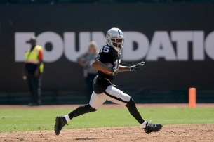 Oakland Raiders wide receiver Michael Crabtree (15) races outside for a gain in the first half as the New York Jets face the Oakland Raiders at Oakland Coliseum in Oakland, Calif., on Sunday, September 17, 2017.