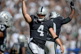 Oakland Raiders quarterback Derek Carr (4) and running back Jalen Richard (30) celebrate after a TD in the second half as the New York Jets face the Oakland Raiders at Oakland Coliseum in Oakland, Calif., on Sunday, September 17, 2017.