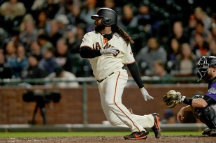 San Francisco Giants starting pitcher Johnny Cueto (47) singles in the fifth inning as the Colorado Rockies face the San Francisco Giants at AT&T Park in San Francisco, Calif., on Tuesday, September 19, 2017.