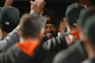 San Francisco Giants starting pitcher Johnny Cueto (47) is congratulated after scoring in the fifth inning as the Colorado Rockies face the San Francisco Giants at AT&T Park in San Francisco, Calif., on Tuesday, September 19, 2017.