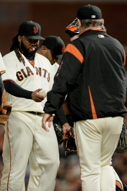 San Francisco Giants manager Bruce Bochy (15) removes starting pitcher Johnny Cueto (47) from the game in the sixth inning as the Colorado Rockies face the San Francisco Giants at AT&T Park in San Francisco, Calif., on Tuesday, September 19, 2017.