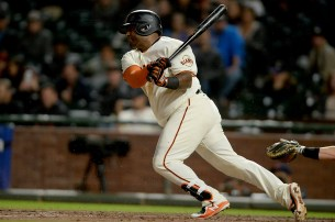 San Francisco Giants third baseman Pablo Sandoval (48) singles in the ninth inning as the Colorado Rockies face the San Francisco Giants at AT&T Park in San Francisco, Calif., on Tuesday, September 19, 2017.
