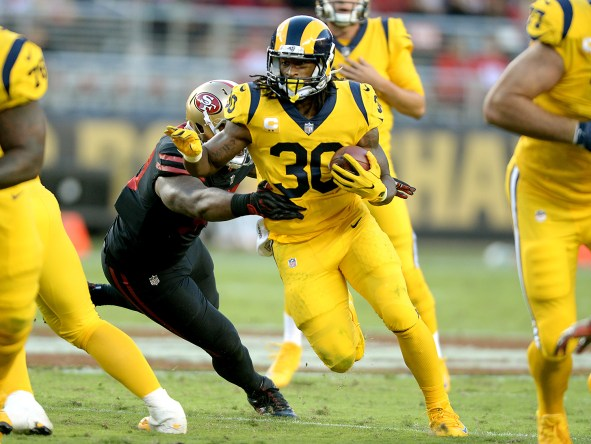 Los Angeles Rams running back Todd Gurley (30) evade a tackle by San Francisco 49ers' DeForest Buckner (99) in the first half as the Los Angeles Rams face the San Francisco 49ers at Levi's Stadium in Santa Clara, Calif., on Thursday, September 21, 2017.