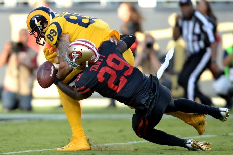 San Francisco 49ers' Jaquiski Tartt (29) breaks up a pass intended for Los Angeles Rams tight end Tyler Higbee (89) as the Los Angeles Rams face the San Francisco 49ers at Levi's Stadium in Santa Clara, Calif., on Thursday, September 21, 2017.