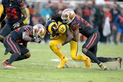 San Francisco 49ers' Rashard Robinson (33) and Jimmie Ward (25) stop Los Angeles Rams wide receiver Sammy Watkins (12) as the Los Angeles Rams face the San Francisco 49ers at Levi's Stadium in Santa Clara, Calif., on Thursday, September 21, 2017.
